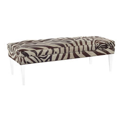 "Lee Industries - Bradley Ottoman in Zora Hide - On-trend animal print becomes the showpiece of a living room with this rectangular Zebra ottoman. Contrast buttons, topstitching and welt create a tailored appearance, while tapered legs in clear acrylic lighten the look for a modern touch. 59""W x 27""D x 19""H; Lucite legs; Zora chocolate upholstery; Bahama brown topstitching and welt; Made in the USA using sustainable, eco-friendly production practices"