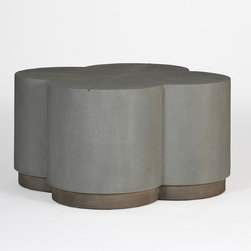 Robinson Coffee Table - The quatrefoil-shaped coffee table is a mixture of faux shagreen and sturdy oak. A versatile, eclectic conversational piece for any living room, the tabletop features a metal inlay, and measures 31.75 inches  in both length and width. It stands 18 inches high.