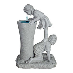 EttansPalace - Tall Refreshingly Girl and Boy Sculptural Fountain - Intrigued by the entrancing water music that cascades from the center spout into the basin, these young children echo the child in all of us as they help each Their get a leg up for a quenching drink of water! This more-than-two-foot-tall, exclusive fountain is cast in quality designer resin with a faux stone finish and makes a refreshingly distinctive addition to home or garden as well as an heirloom investment in garden art. Includes UL-listed, indoor/outdoor pump.
