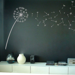 Dali Decals - Dandelion Blowing in the Wind Wall Decal - Ever wonder what you're going to put on that big blank wall in your home? The answer, my friend, may be blowing in the wind. This vinyl wall decal depicts a diaphanous dandelion and comes with 20 wispy seeds to place in your space. Make a wish for graphic style.