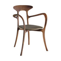 Ma Belle Chair - This chair gives a big nod to mid-century modern style while the slender legs and arms provide curves reminiscent of Art Deco pieces. Also available in an armless side chair version.