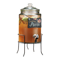 """Home Essentials - Cylinder Beverage Dispenser With Chained Black Board On Rack - Help yourself! Serving Sangria, punch, water or any beverage just became a lot easier with the drink dispenser. Sliding your glass underneath the Push Down Leak Proof Spout to fill up means no more heavy pitchers to lift or splatter to clean. The wrought iron stand or rack will keep the hostess at ease and guests feeling comfortable. This 1.5 Gallon Cylinder Beverage Server is a wonderful serving piece for any outdoor or indoor entertaining.  The Chained Erasable Name Plate is a cute and fun addition to this party centerpiece.   * Tablet is Erasable * 1.5 Gallon Capacity * Dimensions: Height 19 1/2"""" x 9 1/2"""" (Stand included in height)"""