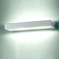 """Leucos - Leucos Alias 35 wall sconce - The Alias 35 wall sconce from Leucos  has been designed by Works Studio in 2004. This wall mounted luminaire is great for halogen lighting. The Alias is constructed of a satin Pyrex diffuser with a metal structure that is available in a white, chrome or satin steel finish. The Alias 35 wall sconce features a sleek and lustrous design, along with quality craftsmanship, that is sure to brillianty illuminate any modern atmosphere.  Product Details:   The Alias 35 wall sconce from Leucos  has been designed by Works Studio in 2004. This wall mounted luminaire is great for halogen lighting. The Alias is constructed of a satin Pyrex diffuser with a metal structure that is available in a white, chrome or satin steel finish. The Alias 35 wall sconce features a sleek and lustrous design, along with quality craftsmanship, that is sure to brillianty illuminate any modern atmosphere.  Details:      Manufacturer:     Leucos       Designer:    Works Studio      Made in:    Italy      Dimensions:     Height: 1 5/8"""" (4 cm) Width: 13.75"""" (35 cm)      Light bulb:     2 X 150W halogen      Material:     Pyrex, chrome"""