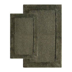 Chesapeake Merchandising - 2 Piece Naples Bath Rug Set - 38240 - Shop for Mats and Rugs from Hayneedle.com! Step out of the shower and onto luxurious style with the 2 Piece Naples Bath Rug Set. The non-slip latex backing will assure you a safe step while the soft tufted goodness will make your tootsies happy. This set is made from 100% durable cotton and available in a variety of fetching colors to coordinate with your decor. Set Dimensions: Large rug: 24 x 40 inches Small rug: 21 x 34 inches About Chesapeake Merchandising Inc. Started in Maryland in 1995 Chesapeake Merchandising Inc. remains dedicated to producing quality textiles from the finest raw materials. Purveyors of fine rugs linens pillows and bedding they strive to stay abreast on the latest trends in the industry in order to provide their customers with the most up-to-date styles for their homes. Chesapeake employs dedicated workers with a passion for quality. Their facilities are located in both India and the United States; their permanent showroom is located in New York New York.