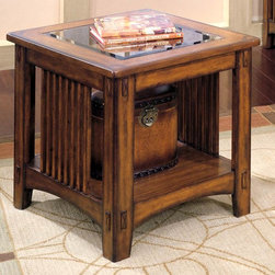 Standard Furniture - American Bungalow Side Table - Millers - Ideal for use next to a sofa the Millers American Bungalow Side Table has a rustic feel with warmth and friendliness embedded in the welcoming tones of the Oak veneers.  Inspired by the American Arts and Crafts movement of the early 20th Century this table features a beveled glass insert table top and a small storage shelf below for displaying items. * This collection was inspired by the American Arts and Crafts movement of the early 20th Century.. It is a restoration of the American Bungalow Life style combined with the casual flavor of today.. The tables create instant eye appeal through beveled glass inserts on tops.. There is a shelf on the bottoms for added storage.. Decorative through mortise and tenon joints adorn each piece.. Quality veneers over wood products and select solids are used throughout. Group may contain plastic parts.. A deep chestnut brown color with striking highlights and is embellished with hand worn edges. Oak color veneers.. Surfaces clean easily with a soft cloth.. Side Table: 28 L x 25 W x 25 H in.