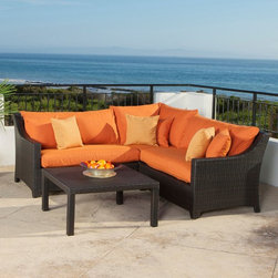 RST Brands - RST Outdoor Deco Tikka 4 Piece Corner Sectional Sofa and Coffee Table Set Multic - Shop for Tables and Chairs Sets from Hayneedle.com! Make your backyard a cool calm place to enjoy your summer evenings with the RST Outdoor Tikka 4 Piece Corner Sectional Sofa and Coffee Table Set. This handsome alfresco patio set effortlessly blends a simple and clean modern design with the classic charm of deep comfort. Constructed from 100-percent recycled rattan wicker this eco-friendly set features hand-woven wicker with durable aluminum frames. For longevity of use the powder-coated frames are rust-resistant and lightweight for a durable yet graceful set. The rich espresso frames elegantly complement the striking rust orange cushions bringing a simple sophisticated energy to any patio deck or poolside space. For year-round enjoyment the PE wicker remains cool-to-the-touch for comfortable and safe use.Crafted for comfort as well as style this stylish set is fitted with plush five-inch thick Sunbrella fabric cushions. Engineered to be long lasting and durable these cushions are fade- and mildew-resistant for years of adorning your home in style. Great for any poolside area the cushions feature quick-dry technology that resists both sea salt and chlorine.About Red Star TradersSince 2004 Red Star Traders LLC (made up of RST Outdoor RST Living and FlowWall System) has designed and manufactured products in the outdoor living home decor and wall-based organizational products categories. Red Star is a direct import product marketing company. Red Star categories of focus include jewelry boxes men's gifts & furnishings and RTA furniture. Their team of marketing and design professionals can help identify market trends and deliver products that meet target retails with maximum perceived value. Red Star's network of manufacturing partners and overseas production managers insure integrity in production and strict quality control.