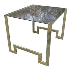 """Brass Greek Key End or Side Table - Perfectly glamorous brass and smoked glass end or side table with Greek key detail! Outsized dimensions make for a great conversation piece--could even be used as a bar cart or small buffet! Vintage 70s piece of wonderful quality reminiscent of designs by Charles Hollis Jones, Pierre Cardin and Milo Baughman. Brass frame is in very good vintage condition with only minor wear and overall light scratching consistent with age and use--nothing offensive and nothing that would be noticed in use. Smoked glass is in overall very good condition, but does have a long chip in one corner. It is useable and doesn't look bad (you don't notice it in use), but we have priced the piece with glass replacement in mind. Dimensions: 28""""l x 23.75""""w x 25""""h"""