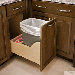 KraftMaid: Auto-Open Wastebasket - When you bump KraftMaid's Auto-Open Wastebasket with a hip or knee, it automatically opens. Perfect for when your hands are full or dirty in the kitchen.