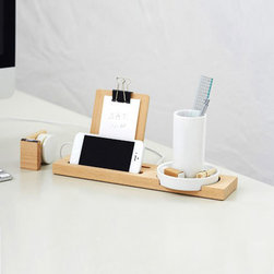 "Minimalist Desk Assistant - Ceramic & Wood - Here's a desk organizer that would pass muster in Jony Ive's office. Minimalist with a slender silhouette, this wood and ceramic desk assistant can hold paperclips, writing tools, rulers, and a smart phone, and there's a handy space to clip on a 3"" x 4"" sheet of paper. Versatile enough for anywhere from the bedroom to the home office. Tray features grooves to hold the charging portion of the iPhone 4/4s/5 when not in use."