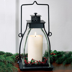 Square Bell Jar Lantern - The tapered shape of this lantern makes it unique. It has a heavy jar that both looks great and projects the light. It's great for setting the scene for an outdoor dinner party.