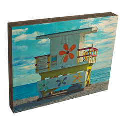 Walnut Hollow - Lifeguard Hut, White Print - Birch wood print with pine frame finished in oynx. The unique process embeds the image directly into the wood surface, maintaining quality, detail, and resolutions of original image while allowing natural wood grain and texture show through.  Routed groove in back allows for easy hanging.   Made in America.