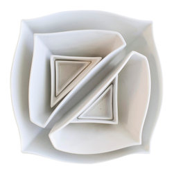 """Haand - Squares + Triangles - Nesting bowl shapes based on a square subdivided into triangles. Through exposure to high temperatures, the porcelain moves and begins to assume both a circular and angular form, creating a shape that is both sharp and fluid. These unique shapes are fun to build a meal around- Starting with a main dish or salad in the Square, a side or soup in the Large Triangle and down to the smaller triangles which  are perfect for sauces or individual guest's salt and pepper. The """"Squares & Triangles Set"""" includes : 1 Square Bowl, 2 Large Triangles, 2 Medium Triangles, and 2 Small Triangles."""