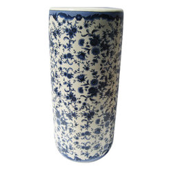 "n/a - Rustic Chinese Porcelain Umbrella Stand with Blue & White Floral Design - This 18"" high blue and white porcelain Umbrella Stand features a classic oriental floral design.  This striking piece is both functional and elegant as either an umbrellla stand or a vase for floral arrangements.  Add one of our rosewood vase stands available in a variety of styles and sizes (including pedestal stands) to enhance its presentation. We recommend an 8"" diameter stand."