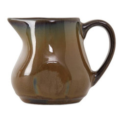 Tuxton - Artisan 4 oz Creamer Mojave - Case of 12 - Each piece looks and feels as if it was handthrown creating a rustic and unique presentation. The lush vibrant glazes react differently with each firing so every piece is truly an original. Available in three colors inspired by the deserts of California: Mojave Night Sky and Red Rock.