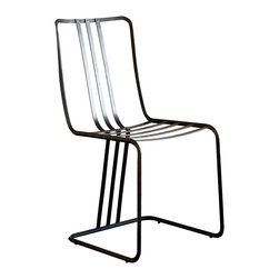 Caporali - Eroe Chair by Caporali - Tuscany, Italy - Hand forged in the Caporali workshop (Santa, Mama, Tuscany Italy), the Eroe Side Chair represents the company's movement into cutting-edge contemporary design. Since 1885, the Caporali family has been forging classic iron pieces in Tuscany using the same mortise and tenon methods passed down through four generations. The Eroe chair continues the tradition of classic iron forging, but with a contemporary flair evoking a touch of industrial and eclectic style. The unique construction with a curved back and seat area supported by three iron strips extending from the seat to the base ensures comfort and stability. The three-sided base allows the fourth to remain open for foot and leg movement. This chairs is a perfect in a country home or city apartment with a more contemporary design aesthetic.