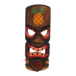 11 Inch Angry Tiki Wall Mask Pineapple Hand Painted - This awesome, angry looking tiki wall mask is hand-carved from Indonesian Albessia wood, and hand-painted to show off the detail. It features a carved and painted pineapple at the top and a big grimace on the face of the idol. Measuring 11 1/2 inches tall, 4 3/4 inches in wide, it looks great outdoors in patios and tiki bars, or indoors in dens and living rooms. This wall hanging makes a great gift for friends and family. NOTE: Since these are hand carved and hand painted, there may be slight color or facial differences from the pictures.