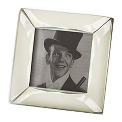 Menton Small Mirrored Frame - 3 x 3 - Diminutive yet stunningly dramatic, the Menton Small Mirrored Frame presents your treasured photograph or precious paper souvenir in a classic yet marvelously modern style. The simple construction allows the glimmering mirror surface to catch the eye, whether placed among a still life collection on a sideboard or displayed bedside in the boudoir.