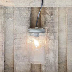 Mason Jar Lamp - Mason jars and exposed light bulbs are all the rage these days. Why not combine the two with the Mason Jar Lamp? Hang this up in any space for a charmingly vintage look.