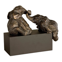Uttermost - Playful Pachyderms Bronze Figurines - It's a tug of war and there's no knowing which one wins. You'll be a winner when you add these wonderful antiqued bronze figurines to your collection. Each time you see them they will bring a smile to your lips.