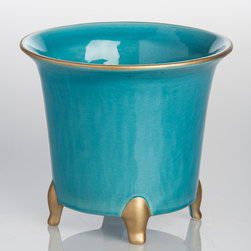Turquoise Round Cachepot with Gold - A stunning glaze of brilliant tropical-ocean turquoise makes the classic shape of this Cachepot fresh, inviting your creativity in filling the ceramic pot or placing it as part of a tablescape.  Curved metallic gold legs bring a subtle impression of the regal to a pot rimmed in matching gold.  The whole look adds a touch of imperial grandeur without ostentation to the landscape of everyday life.