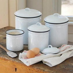White Enamelware Canister Set - White enamelware with black trim has a vintage look, and the clean fresh look of this set keeps things up to date as well. Perfect for storing your baking needs in a cute and convenient way.