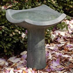 Campania International - BirdBath: Oslo Bird Bath - Shop for Garden Bird Baths from Hayneedle.com! What We Like About the Oslo Bird Bath Make sure birds can enjoy a refreshing dip on hot summer days with the charming Oslo Bird Bath. A stylish curved bowl with 18-inch diameter easily accommodates multiple birds. Available in an array of natural finishes to match any outdoor setting.About Campania InternationalEstablished in 1984 Campania International's reputation has been built on quality original products and service. Originally selling terra cotta planters Campania soon began to research and develop the design and manufacture of cast stone garden planters and ornaments. Campania is also an importer and wholesaler of garden products including polyethylene terra cotta glazed pottery cast iron and fiberglass planters as well as classic garden structures fountains and cast resin statuary.Campania Cast Stone: The ProcessThe creation of Campania's cast stone pieces begins and ends by hand. From the creation of an original design making of a mold pouring the cast stone application of the patina to the final packing of an order the process is both technical and artistic. As many as 30 pairs of hands are involved in the creation of each Campania piece in a labor intensive 15 step process.The process begins either with the creation of an original copyrighted design by Campania's artisans or an antique original. Antique originals will often require some restoration work which is also done in-house by expert craftsmen. Campania's mold making department will then begin a multi-step process to create a production mold which will properly replicate the detail and texture of the original piece. Depending on its size and complexity a mold can take as long as three months to complete. Campania creates in excess of 700 molds per year.After a mold is completed it is moved to the production area where a team individually hand pours the liquid cast stone mixture into the mold and employs special techniques to remove air bubbles. Campania carefully monitors the PSI of every piece. PSI (pounds per square inch) measures the strength of every piece to ensure durability. The PSI of Campania pieces is currently engineered at approximately 7500 for optimum strength. Each piece is air-dried and then de-molded by hand. After an internal quality check pieces are sent to a finishing department where seams are ground and any air holes caused by the pouring process are filled and smoothed. Pieces are then placed on a pallet for stocking in the warehouse.All Campania pieces are produced and stocked in natural cast stone. When a customer's order is placed pieces are pulled and unless a piece is requested in natural cast stone it is finished in a unique patinas. All patinas are applied by hand in a multi-step process; some patinas require three separate color applications. A finisher's skill in applying the patina and wiping away any excess to highlight detail requires not only technical skill but also true artistic sensibility. Every Campania piece becomes a unique and original work of garden art as a result.After the patina is dry the piece is then quality inspected. All pieces of a customer's order are batched and checked for completeness. A two-person packing team will then pack the order by hand into gaylord boxes on pallets. The packing material used is excelsior a natural wood product that has no chemical additives and may be recycled as display material repacking customer orders mulch or even bedding for animals. This exhaustive process ensures that Campania will remain a popular and beloved choice when it comes to garden decor.Please note this product does not ship to Pennsylvania.