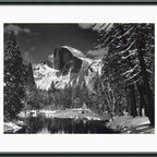 """Amanti Art - """"Half Dome, Winter – Yosemite National Park, 1938"""" Framed Print by Ansel Adams - An Ansel Adams print can be the height of sophistication, and one of America's most recognized monuments reaches the pinnacle of good taste. Black and white photography by this American master never goes out of style, so you can hang it over the mantle knowing it will last for generations."""