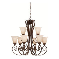 BUILDER - BUILDER Traditional Chandelier X-ZT8281 - Warm finishes compliment the traditional look and classic design of this Kichler Lighting chandelier. Multiple tiers and scrolling arms create a grand look that has been highlighted by a rich toned Tannery Bronze finish. It also features distressed umber glass shade that cast warm illumination in any setting.