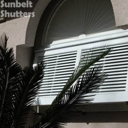 Bahamas Shutters - This Bahamas shutter is Open Louver Style (louvers are angled at 45 degrees), but still provides privacy to a bathroom window.