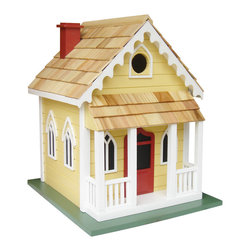 """Home Bazaar Inc. - Chatham Cottage - Yellow with Red Door - Located at the """"elbow"""" of Cape Cod, Chatham has a long history as a shipping, fishing, and whaling center. Chatham's early prosperity would leave it with a considerable number of 18th century buildings whose charm helped it develop into a popular summer resort. Our fully, functional birdhouse features gingerbread fretwork along the roof line and a porch to watch the world go by on a warm summer evening. A removable back wall, drainage, ventilation, an unpainted interior and a 1.25 """" hole size will invite nesting birds in and keep larger ones out. The finish is an outdoor, water-based, non-toxic paint."""