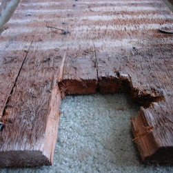 Nantucket reclaimed lumber heart pine counter top - Here is a good picture of the condition of the wood that we used to make the counter top. It included cut nails and screws found all throughout the boards.
