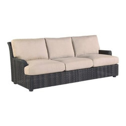 Whitecraft - Whitecraft Aruba Sofa - As its name implies this All-Weather outdoor seating collection is the epitome of luxurious island style. Comfort is key as Aruba's woven frames' edges are gently rounded and the spacious thickly padded cushions encourage extended lounging or relaxed entertaining. The occasional tables are topped with teak and the collection is finished in a deep Amazon Mahogany. Aruba will endure seasons of tradewinds sea spray and sunshine beautifully.As firm believers in tradition and a strong belief in the art of craftsmanship Woodard has acquired Whitecraft Furniture the longest-lasting wicker company in the U.S. While wicker is known for its strength and durability those attributes are overshadowed by the ingenuity and elegance of Whitecraft furniture. Handcrafted and built to last. Whitecraft by Woodard is the beautiful woven patio furniture counterpart to Woodard's wrought iron and aluminum lines. With a variety of styles and finishes to fit your outdoor needs. Escaping to your own private outdoor oasis soothes the soul. Whether you're looking to create a casual seating area a sophisticated outdoor dining space or a complete outdoor room you'll find everything you need right here. Make a personal style statement—elegant exotic traditional modern or transitional—whether you have a covered porch deck pool-side patio or garden nook. We have the styles finishes fabrics and designs to fit any need. Whitecraft patio furniture has been creating hand-crafted patio furniture for almost 100 years. Whitecraft patio furniture quality designs and comfort have allowed Whitecraft the opprotunity to enlarge their offerings year after year.