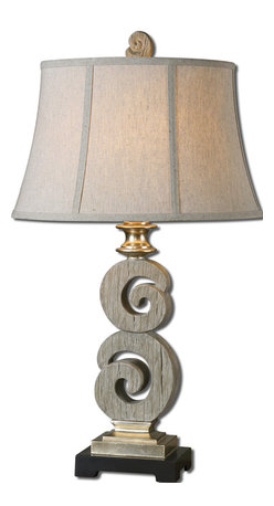 Uttermost - Delshire Wood Table Lamp - If you are attracted to bleached wood and white accents in your space, this table lamp fills those needs. The handsome, carved bleached wood base has a light gray wash that complements the antique silver and black foot. The finial on the shade matches the wood but lets the oatmeal shade take the prize.
