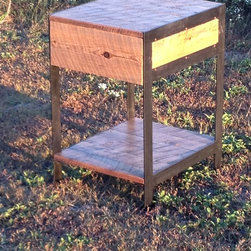 "Metal Leg side table - This Side table by The Rusted Nail is a combination of cold steel and warm barn wood. The legs/sides are made of 1/4"" steel welded together and painted black. The wood is reclaimed barn wood that is sealed with a water based polyurethane.This table features a drawer crafted with durable shop made wooden slides, and a lower wooden shelf for storage. Dimensions: 20"" wide, 22"" deep and 29"" tall, Drawer is 7"" deep.Please allow 2-3 weeks to ship from time of the order is placed."
