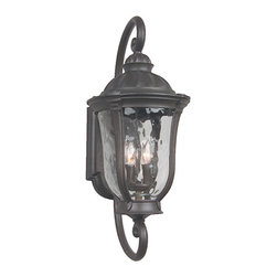 Exteriors by Craftmade - Frances Medium Outdoor Wall Mount - Dramatic styling and rugged cast construction give this outdoor lantern superb appeal.  Its durable pro-tech oiled bronze finish and hammered clear glass pair handsomely.  The backplate measures 5W x 12H.  Exteriors by Craftmade - Z6010-92