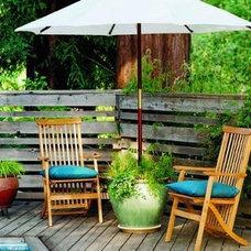 umbrella in pot with plants
