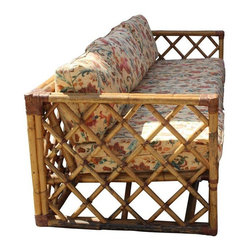 """Pre-owned Vintage Rattan Sofa Philippines Import - A vintage rattan sofa imported from the the Philippines. This piece features solid, tough rattan stems with almost 2"""" diameter! Rattan furniture is much stronger than bamboo, which is hollow.     The sofa features newly upholstered custom made fitted loose cushions with piping. All cushions and pillow have zippers, easy to remove and wash. The lining under the cushions has recently been replaced. The sofa has its original yellow-gold finish, which could use a new clear coat. It has gorgeous diamond-detailed fretwork all around, including the backs! All of the leather binding is present and without tears.     The sofa comes from a pet-free and smoke-free environment. It was kept under a fully covered patio and protected with individual covers off-season. The sofa has had only one owner and is ready for a new home or makeover!    This piece is part of a hard to find full set! Each piece is listed separately. Please see seller's other listings. Other items listed: A pair of chairs, a coffee table and side tables.     Listing includes:  1 sofa 3 seater 83""""l x 32""""d x 24""""h  1 magazine rack 19ʺw × 12ʺd × 20ʺh (this alone sells for $150.00)"""