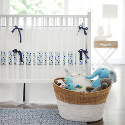 New Arrivals - New Arrivals Crib Bedding White Pique with Navy - Reflecting the whimsy and joy of life, New Arrivals delivers fun and function to a child's room. The White Pique crib bedding's beautiful mix of solid color fabrics awakens a space with contemporary style. This white pique set includes a sophisticated bumper and bed skirt with navy ties. Optional crib sheet available. Bumper offers optional customizable initials, first name, middle name or last name monogram in a variety of fonts and hues. Crib sheet and crib skirt made in the USA.