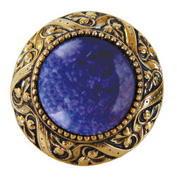 "Inviting Home - Victorian Knob (antique brass with blue sodalite) - Victorian Knob in antique brass with blue sodalite semi-precious stone 1-3/8"" diameter Product Specification: Made in the USA. Fine-art foundry hand-pours and hand finished hardware knobs and pulls using Old World methods. Lifetime guaranteed against flaws in craftsmanship. Exceptional clarity of details and depth of relief. All knobs and pulls are hand cast from solid fine pewter or solid bronze. The term antique refers to special methods of treating metal so there is contrast between relief and recessed areas. Knobs and Pulls are lacquered to protect the finish.  Blue Sodalite Semi-Precious stone. Blue Sodalite is a royal blue colored stone that usually has some white or gray-colored streaks. Blue Sodalite looks a bit more crystal-like. It was named by Professor Thomas Thompson who was called in to identify the specimen that was brought from Greenland to Denmark during the time of the Napoleonic wars - he identified it at first as Sodium Aluminum Silicate Chloride. The stone is associated with the Astrological sign Sagittarius and is thought to promote focus clearing mediation and calming of fears. Victorian Jewel pulls and knobs will allow you to have so much fun with the design. The pulls and knobs come in five different kinds of semi-precious stones: Black Onyx Tiger Eye Blue Sodalite Red Carnelian and Green Aventurine. You can even use all of the different colors of the semi-precious stones on one cabinet facade which would give it an eclectic and playful look."