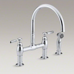 """KOHLER - KOHLER Parq(R) two-hole deck-mount bridge kitchen sink faucet with 9"""" gooseneck, - This Parq kitchen faucet delivers a fresh interpretation of the traditional bridge design, incorporating clean lines for ease of maintenance. The high-arch gooseneck swing spout provides generous clearance over pots and pans, while the separate sidespray pulls down into the sink for easier cleaning and up-close tasks."""