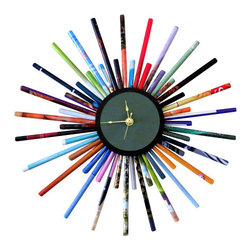 Eco-Friendly Wall Clock - This colorful  sunburst wall clock is a functional home accessory that is also sensationally stylish. Custom handmade from magazine pages, it truly is a work of eco-friendly art.  It is guaranteed to brighten even the gloomiest of rooms in your home. Hang it on a focal wall in your living room or family room. It also can transform a man cave into a more contemporary space.