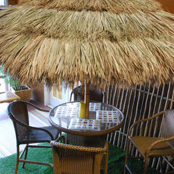 Thatch Umbrella - Natural - Unlike regular umbrellas, thatch umbrellas allow for wind to pass through it,making them ideal to install on any patio, at a restaurant, or beach resort . This Insulation quality is also ideal because the warm air escapes through the thatch , which can cool an environment by approximately 10 degrees.