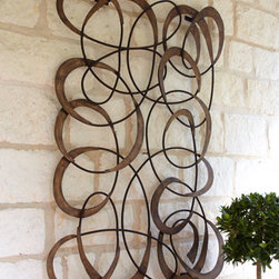 Horchow - Mingling Circles Wall Decor - Intricate dimensional wall decor merges spirals into circles for a mesmerizing display. Imported. Handcrafted of tole metal on an iron frame. Hand-painted, dark golden finish. Eight screw holes for hanging on the wall. Outdoor safe in a covered area...