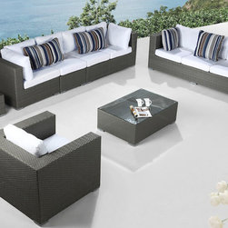 Beliani - Modern Outdoor Furniture Maestro Wicker Lounge Set - This deep seating lounge set comes with a 3-seater sofa,a modular 4-seater,a club chair,coffee table and side table. This grey wicker outdoor lounge set is the ultimate experience for your backyard or patio.
