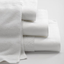 Senses Towels - Tailored luxury for the bath... Senses, ANICHINI's newest collection of toweling is absorbent, functional, chic, and white. With a deep, modern border, the hand of this towel is soft and rich. Stone pre-washing gives a luxurious drape and eliminates shrinkage. All of these terry towels are 600gm, the bath mat is 1000gm.
