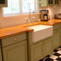 Green cabinets, classic black and white tiled floor - Medallion semi-custom cabinetry
