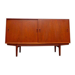 Pre-owned Mid-Century Modern Teak Danish Credenza - This piece is a simple, classic, and perfect Mid-Century modern teak credenza / media stand, made in Denmark. It's the best layout for a media stand with generous, adjustable shelving for components and some streamlined drawers for remotes, DVDs and other accessories (multiple height options). The sliding doors highlight the elegant Danish construction and the brilliant patina signature of vintage teak is cleaned and refinished. There is nothing like super sleek modern design with the unmistakable Scandinavian simplicity and practicality that makes pieces like this so timeless.     It is in good vintage condition with small signs of wear, as expected with vintage furniture (worst of which is pictured above, small chip on upper right back corner) and the doors do not slide smoothly - they do slide completely across but not especially easily, hence the great price.