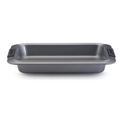 "Anolon Advanced Bakeware 9"" x 13"" Rectangular Cake Pan - Ideal for both everyday and special-occasion baking  the Anolon Advanced Nonstick Bakeware 9-"" by 13-"" Rectangular Cake Pan with Silicone Grips is designed to make baking easier and more efficient. This versatile rectangular cake pan is the go-to pan for baking birthday cakes or even main courses for dinner  and measures up to the high standards of serious home bakers. Constructed of heavy-duty carbon steel in a medium color tone that aids in even browning  this cake pan resists warping and provides the even heat distribution that is so critical for successful baking results.  Product Features      Heavy duty carbon steel construction   Anolon SureGrip handles for a comfortable grip   Oven safe to 450 Degrees F   Durable nonstick surface allows for effortless food release   Limited lifetime warranty"