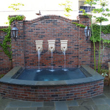 Traditional Pool by Ewing Aquatech Pools