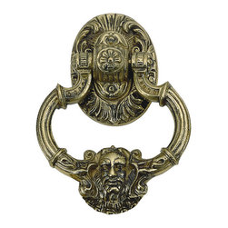 Brass Accents - Solid Brass Neptune Door Knocker - This large very heavy (nearly 4 pounds of solid brass! ). Gothic style door knocker is modeled from the Victorian era. The top portion has an ornate strong relief pattern, while the bottom features the face of Neptune, God of the Sea. Bring the power of Atlantis to your front door!  Available in 12 beautiful finishes.  Shown and priced in antique brass finish.